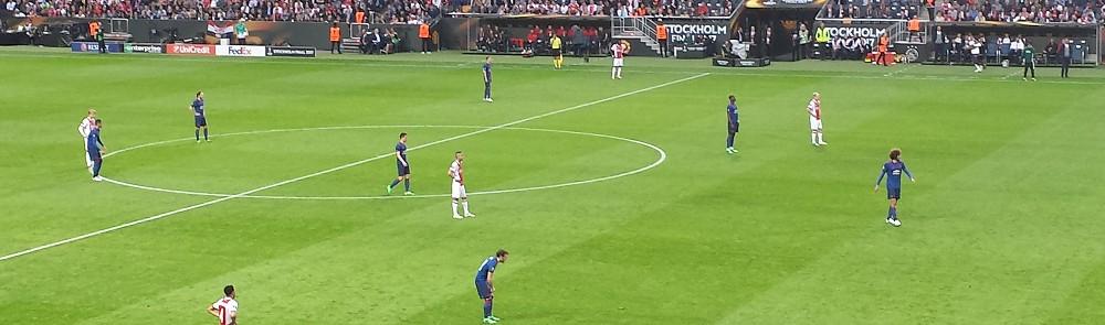 Football Match on Pitch
